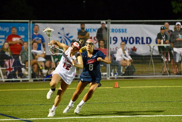 Isabelle Smith defends against a Canadian player.