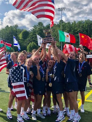 Isabelle Smith and her U.S. teammates celebrate their U19 World Championship after defeating Canada, 13-3, on Saturday.
