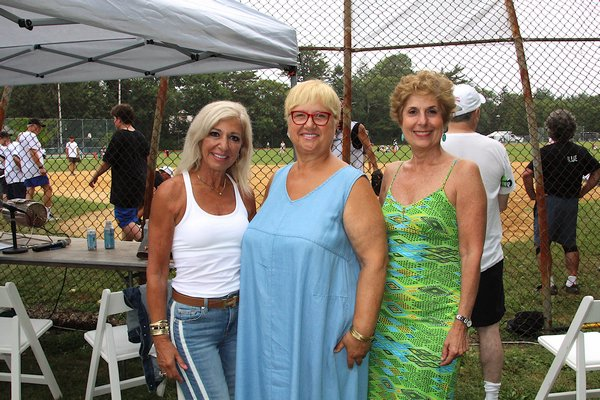 Justice Patricia M. DiMango, left, who threw out the first pitch, with celebrity chef Lidia Bastianich and Juliet Papa of 1010Wins, who did the announcing on Saturday.