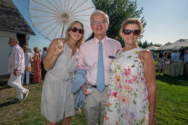 Bridget Fleming with Fred and NancyLynn Thiele during the annual Peconic Land Trust Gala at the Ocean View Farm in Bridgehampton on Sunday evening.