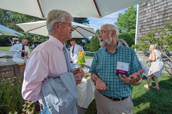 Fred Thiele and John v.H. Halsey chat during the annual Peconic Land Trust Gala at the Ocean View Farm in Bridgehampton on Sunday evening.