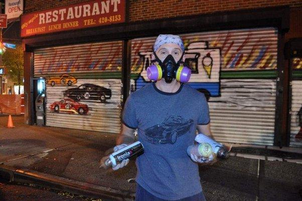 Artist Mitchell Schorr at work on the streets.