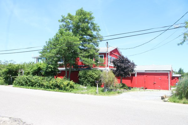 The iconic barn red former Lobster Grill Inn is transforming into Manna Waterfront Restaurant and Bar. PEGGY SPELLMAN HOEY