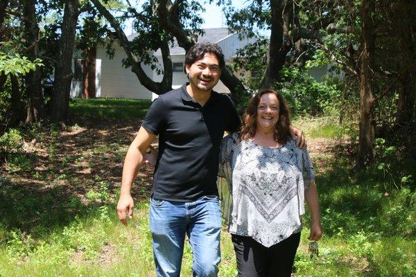 Ryunoske Jesse Matsuoka and Donna Lanzetta take a walk through Manna's property where a fish hatchery is proposed. PEGGY SPELLMAN HOEY