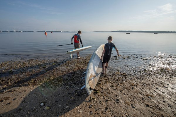 Sean and Liam Attebury walk to the water to paddle together for the very first time as father and son prior to the start of the annual Paddle for Pink at Havens Beach on Saturday morning.