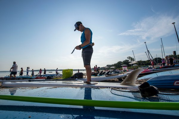 Ari Weller readies himself prior to the start of the annual Paddle for Pink at Havens Beach on Saturday morning.