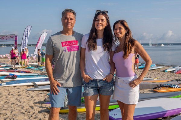 Paddle for Pink founders Larry and Maria Baum with Celebrity Guest of Honor Katie Lee prior to the start of the annual Paddle for Pink at Havens Beach on Saturday morning.
