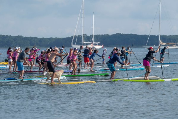 Paddlers leave the starting line during the annual Paddle for Pink at Havens Beach on Saturday morning.