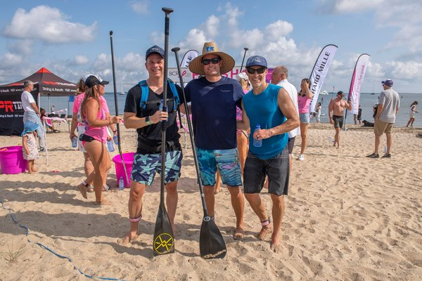 3-Mile Third Place Winner Simon Davey, First Place Winner Chris Hanson (with a time of 38:59) and Second Place Winner Ari Weller during the annual Paddle for Pink at Havens Beach on Saturday morning.