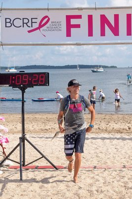 6-Mile Race Winner Michael Fithian crosses the finish line during the annual Paddle for Pink at Havens Beach on Saturday morning.