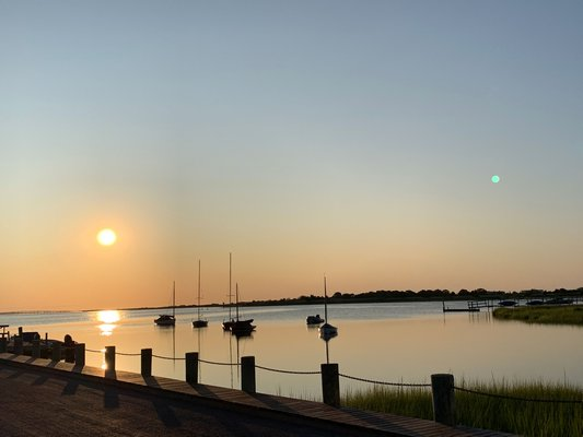 Sunrise at Shinnecock Yacht Club in Quogue just prior to the Quogue Field Club Teen Triathlon on Saturday morning.  COURTESY OF JUNIOR SPORTS