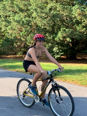 Maggie McCarthy completing the bike portion of the triathlon.