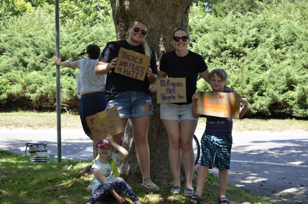 A group of protestors from left to right, Annabel Asker, Catharine Fleming, Laura Asker and Owen Asker. The Askers are from Bridgehampton and Ms. Fleming is from East Hampton Town. ANISAH ABDULLAH