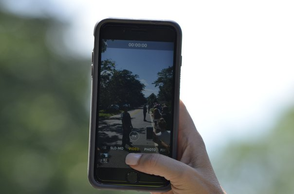 Preparing to capture the president's motorcade on camera. ANISAH ABDULLAH
