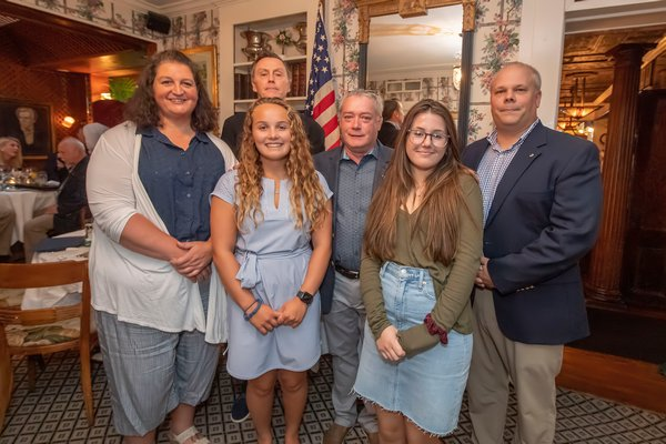 Lions Club Scholarship winners Nancy Hallock (on behalf of her daughter Emily), Paige Schaefer and Ella Knibb with Sag Harbor Lions Club members Paul Zaykowski, Tony Lawless and Mark Poitras during the Lions Club Awards Dinner at the American Hotel on July 24.