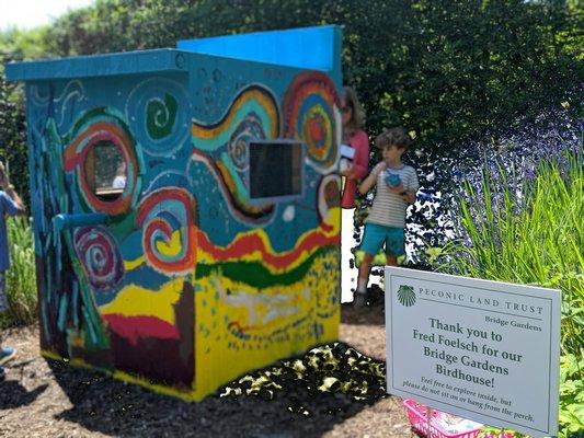 Beckett Hutfilz, a 7-year-old, helps decorate the bird house.