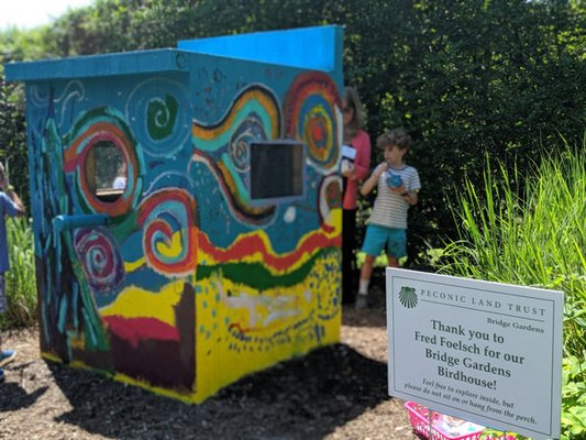 Beckett Hutfilz, a 7-year-old, helps decorate the birdhouse. JENNIFER CORR