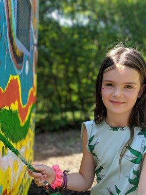 Stella Lynch, aged 7, painting on the birdhouse. JENNIFER CORR