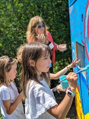 Avery Kelly, age 8, India Muhs, age 6, and Shine art teacher and educator Christina Sahr working on the birdhouse at Bridge Gardens. JENNIFER CORR