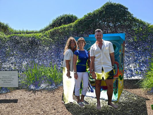 Christina Sahr (left), Kathy Kennedy and Aaron Goldschmidt in front of the birdhouse.