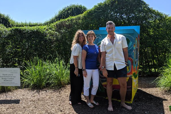 Christina Sahr, Kathy Kennedy and Aaron Goldschmidt in front of the birdhouse. JENNIFER CORR