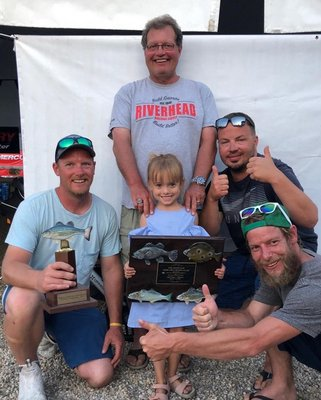 Mike Kromer, left, and his daughter Kacey, show off their second-place trophy from the Mercury Montauk Grand Slam tournament with crewmembers Bill Milia, Marek Janota and Tom Bock.