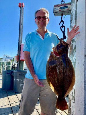George Kok decked this nearly 14-pound fluke while fishing aboard the Mishell II charter boat out of Montauk  last weekend.