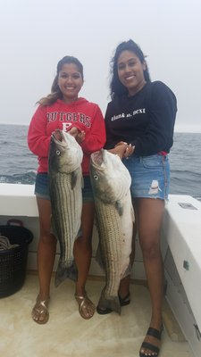 Shelby Bharrat and Bianca Khargie with a couple of nice striped bass they caught while fishing aboard the Blue Fin IV charter boat out of Montauk recently.