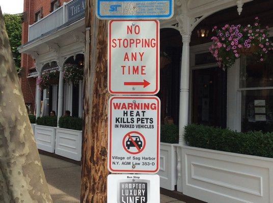 Signs posted in Sag Harbor warn civilians not to leave their pets in the heat.