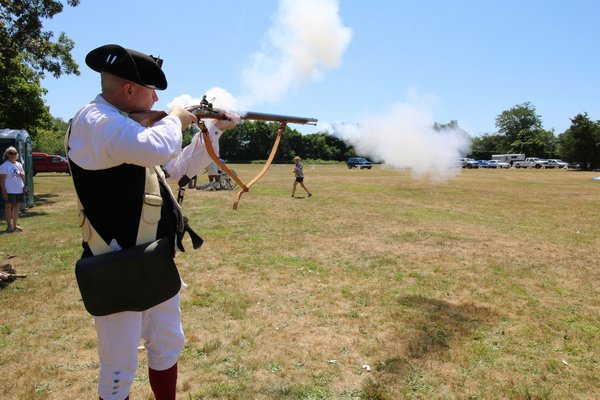David Howell demonstrates a musket.