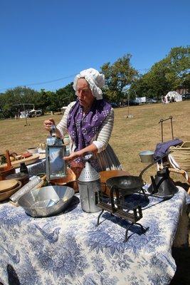 Diane Fish demonstrates camp cooking.