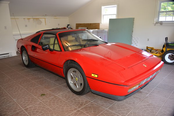 A red 1988 Ferrari was sold at a ope-house showing last week. The car was owned by the previous ower ad had registered less than 6,000 miles.      KYRIL BROMLEY