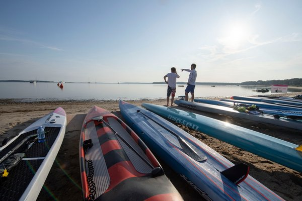 Zach and Jim Rothwell prepare for their paddle prior to the start of the annual Paddle for Pink at Havens Beach on Saturday morning.