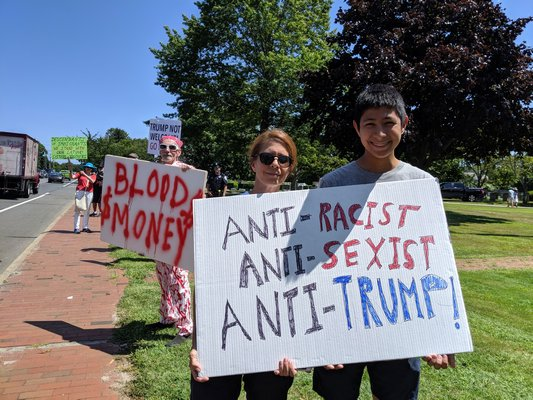 Protesters Sandy Mancini and 14-year-old Leo Yu.