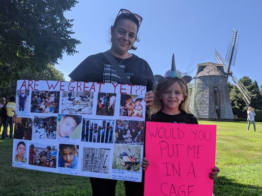 Protesters Lisa Votino and six-year-old Lily Tarrant.