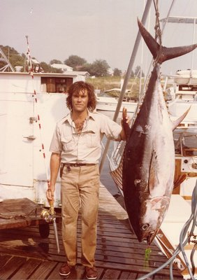 Tred Barta with the 215 pound bigeye tuna he caught on a 20-pound test rated line, a world record that still stands today.