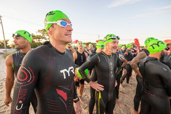 Joris Esch waits to go into the water prior to the start of the Mighty Hamptons Triathlon on Sunday morning.