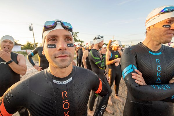 Chris Williams waits to go into the water prior to the start of the Mighty Hamptons Triathlon.