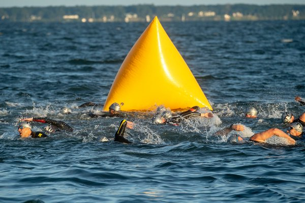 Swimmers start the 38th annual Mighty Hamptons Triathlon on Sunday morning.