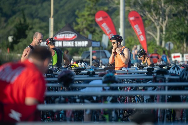 Competitors switch from swimming gear to biking gear in the transition area.