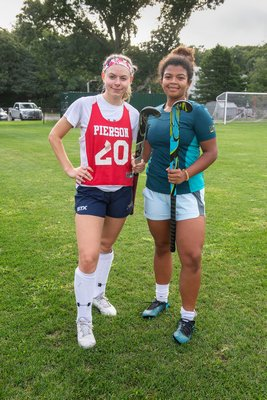 Lady Whalers Joyce Arbia, left, and Mahlia Hemby.