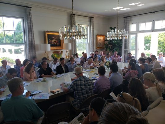 Many people gathered at billionaire John Paulson's home on First Neck Lane in Southampton Village to discuss the newly formed Lake Agawam Conservancy and what can be done to improve the lake's health. GREG WEHNER
