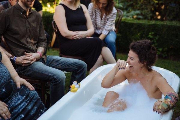 Siobhan O'Loughlin performing in a tub.