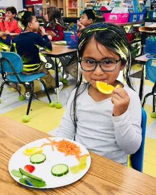 A student finds the WKids Healthy Food for Life Program quite appetizing.