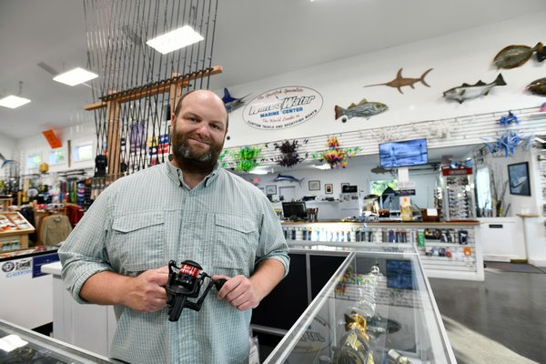 Bryce Poyer, co-owner of White Water Outfitters, in his shop in Hampton Bays.    DANA SHAW