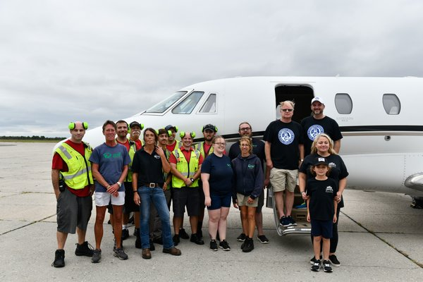 Volunteers and staff from ARF, the Sheltair ground crew, memebers of Jake's Rescue Ranch and pilots Tim Barrett and Jonathan Plesset from Pittsburgh Aviation Animal Rescue Team at Gabreski Airport on Thursday, September 12.