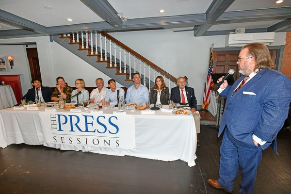 Executive Editor Joseph Shaw poses a question to the panalists at the first-ever Express News Group