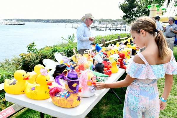 Decorated ducks on display at the Hampton Bays Civic Association's family fund day and duck race on Saturday.