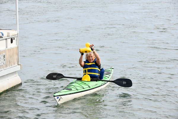 Janice Landis holds up the winning duck.