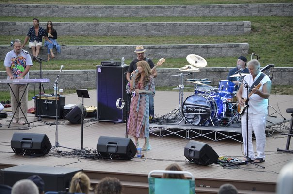 Local cover band P.M. Overdrive performed for the final show of Good Ground Park's summer concert series. ANISAH ABDULLAH
